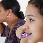 Brushing teeth together 150x150